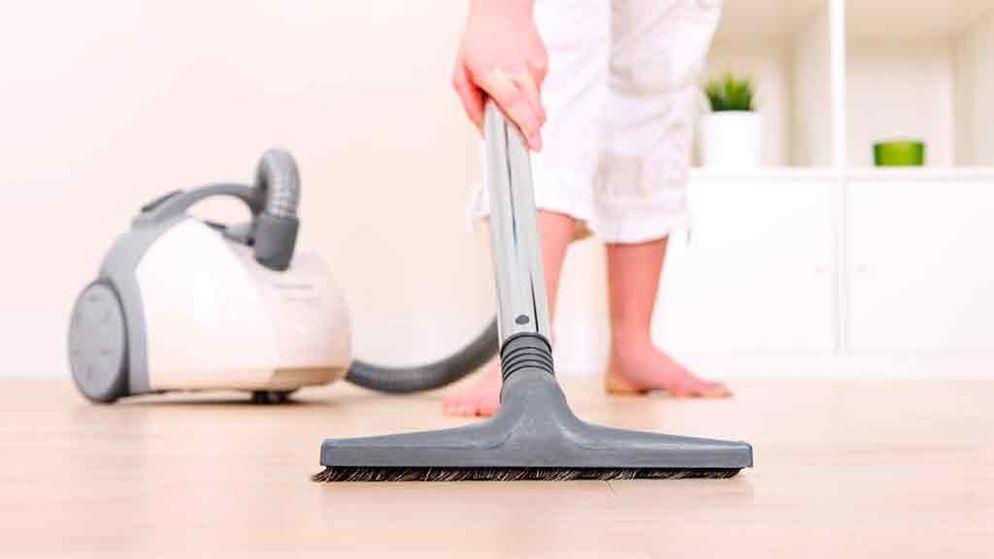 Vacuum Cleaner On Hardwood Floor