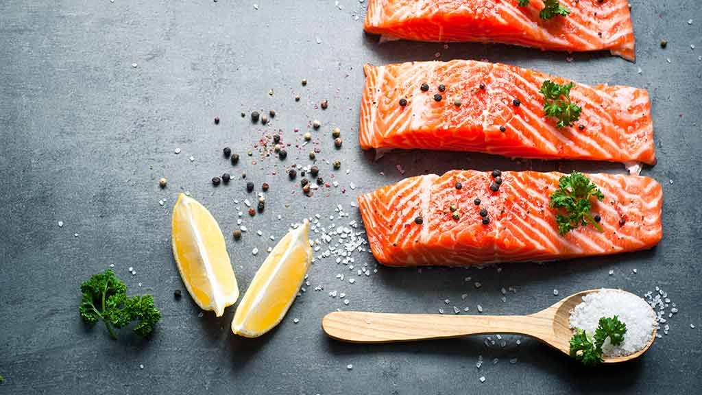 salmon steaks on kitchen board