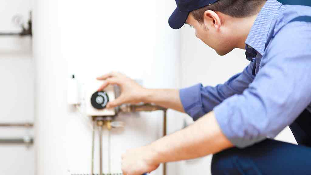 work man checking a hot water system