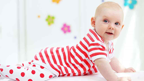 baby wears red stripey jumpsuit