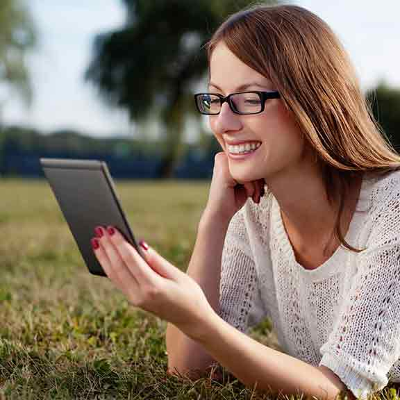 woman in field reads ebook square