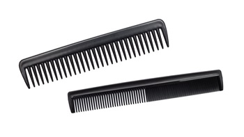 black hair combs on white background
