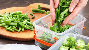 plastic containers with green vegetables