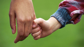 parents holds childs hand