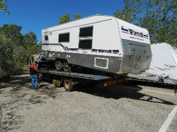 Caravan being towed after suspension failure