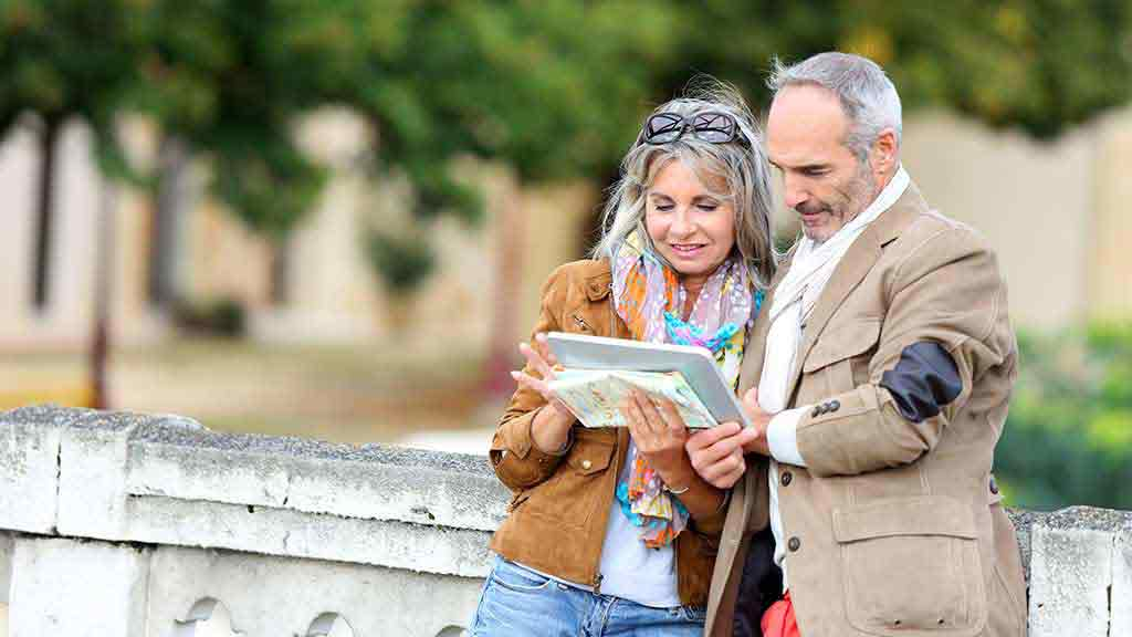 couple checking directions while travelling