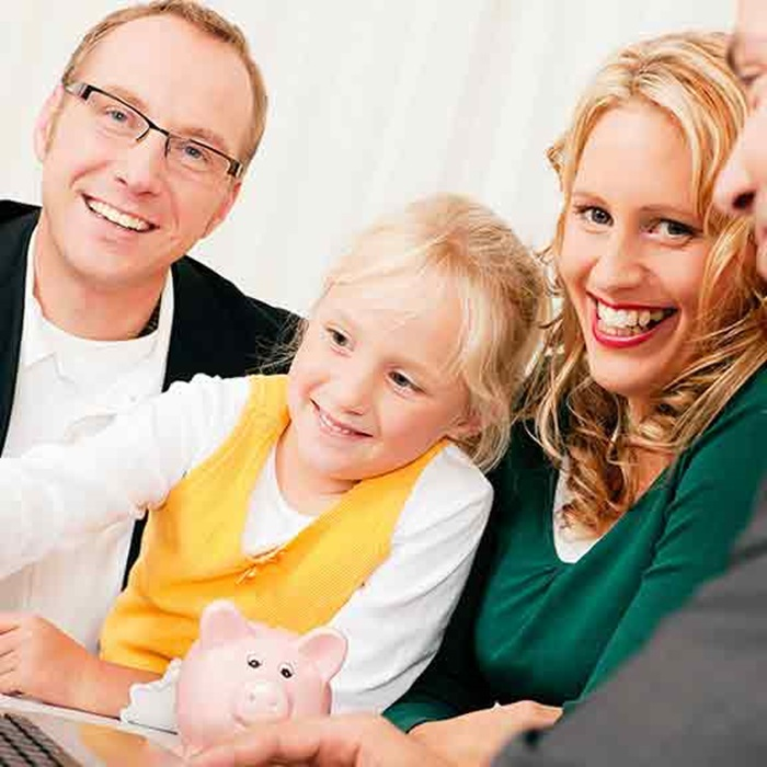 family with piggy bank and laptop square