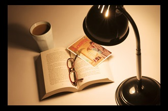 lamp and book with warm lighting