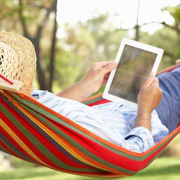 person using tablet on hammock square