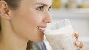 woman drinking diet shake