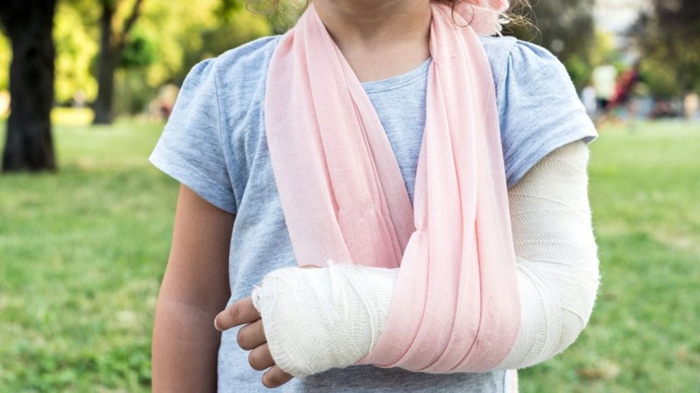 Child with a broken arm in a sling