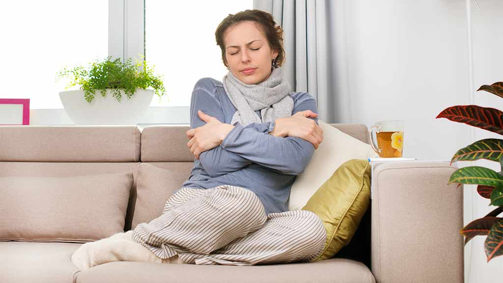 Captivating Woman Freezing On Sofa Photo Gallery