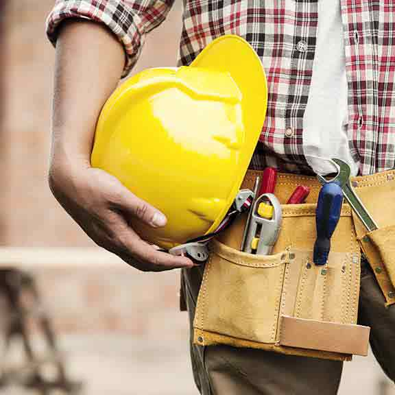 builder holds hard hat square