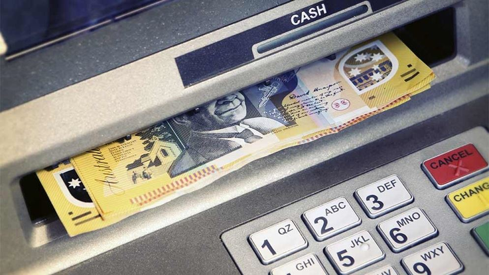 atm ejecting fifty dollar notes