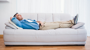 man lying on couch