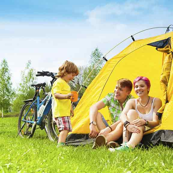 family sitting in a tent square