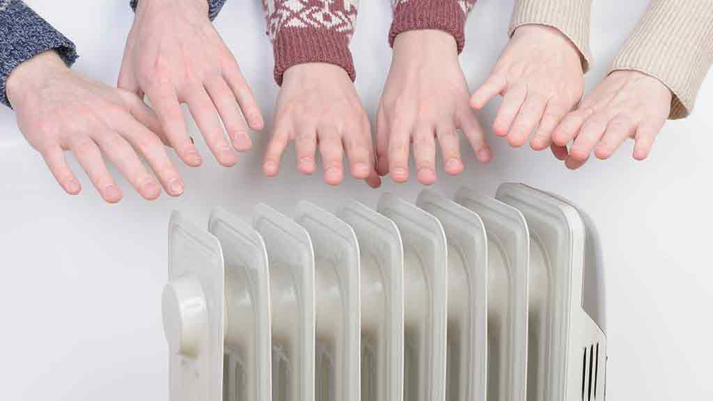 hands held over column heater