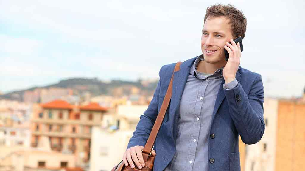 man talks on phone in foreign country