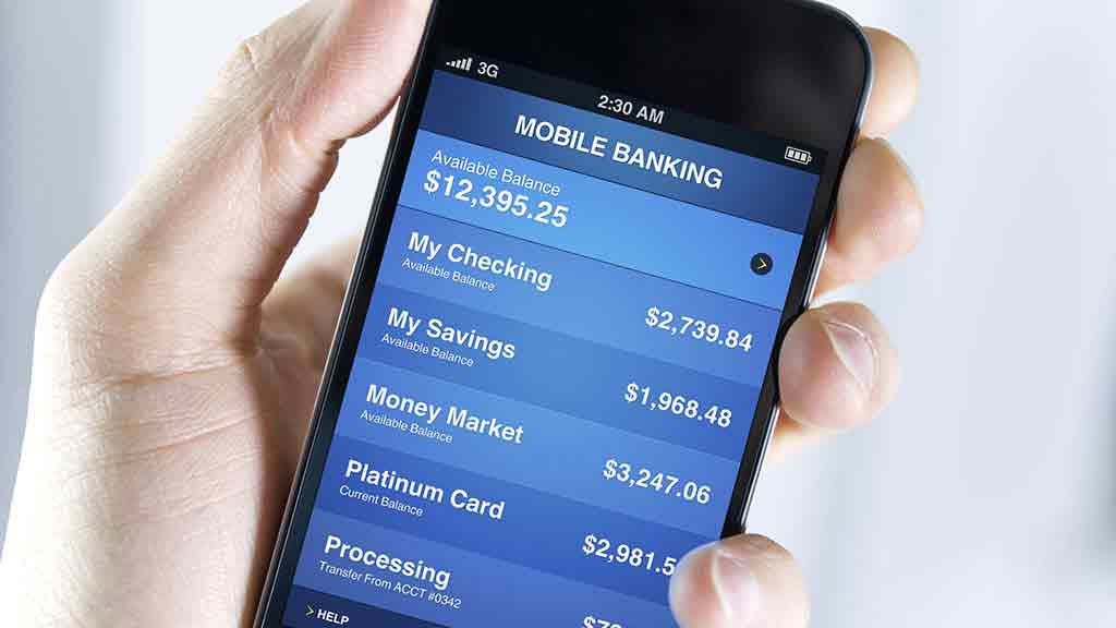 hand holding phone with mobile banking app