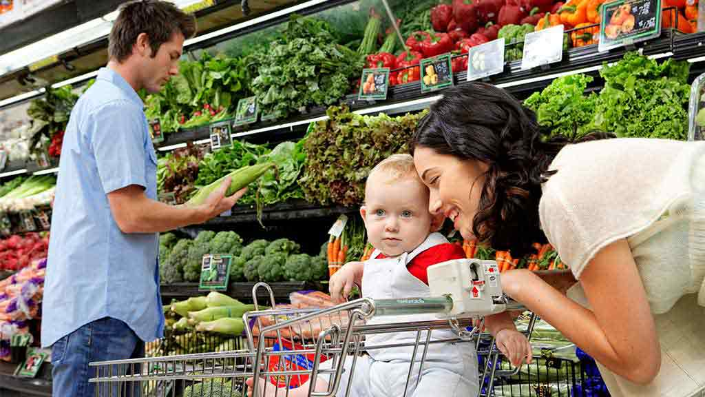 mother and child in the fruit and vegetable section at the supermarket