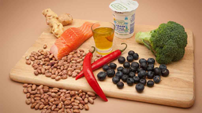 superfoods salmon blueberries chilli broccoli on a board