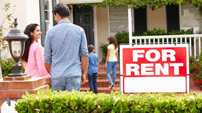 couple enter house with for rent sign