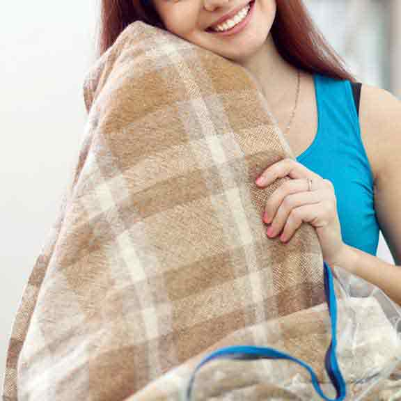 electric blanket and woman square