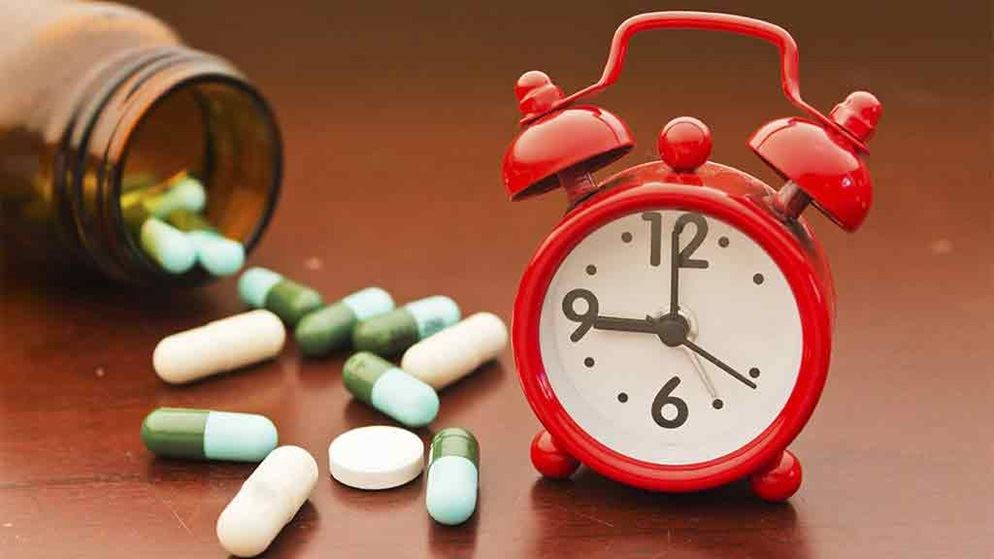 alarm clock and pills container