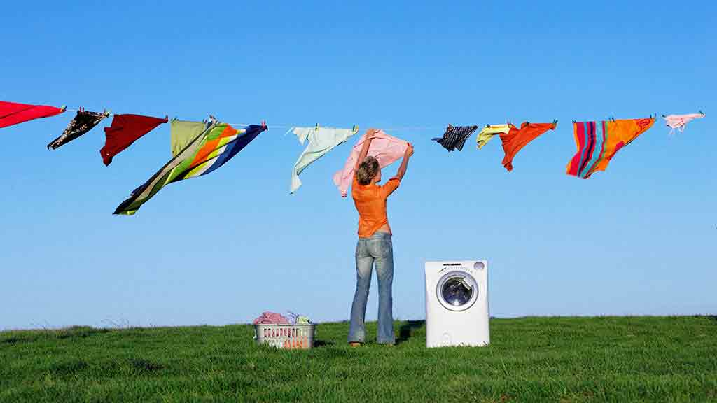 washing machine with lady hanging out clothes
