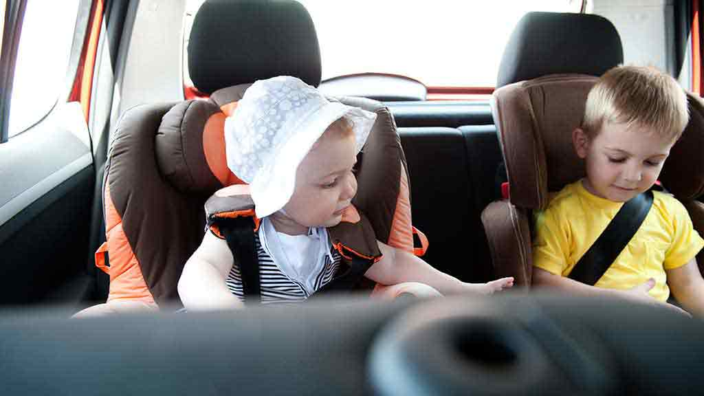 baby girl and little boy in car seats