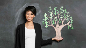 woman holds tree with money growing on it