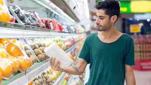 man checking product label in supermarket
