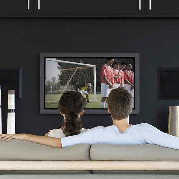 man and woman watch soccer on tv square