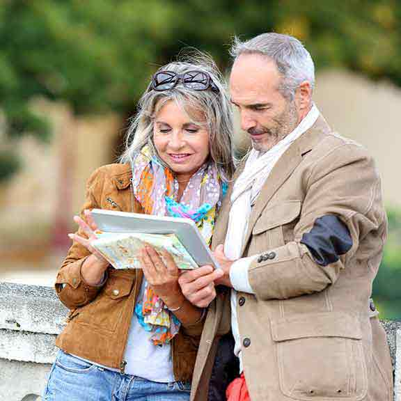 couple checking directions while travelling square