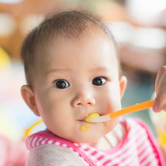 feeding baby with spoon sq