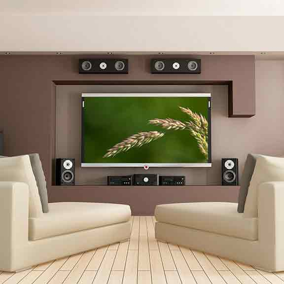 a lounge room with a big tv and home theatre system square
