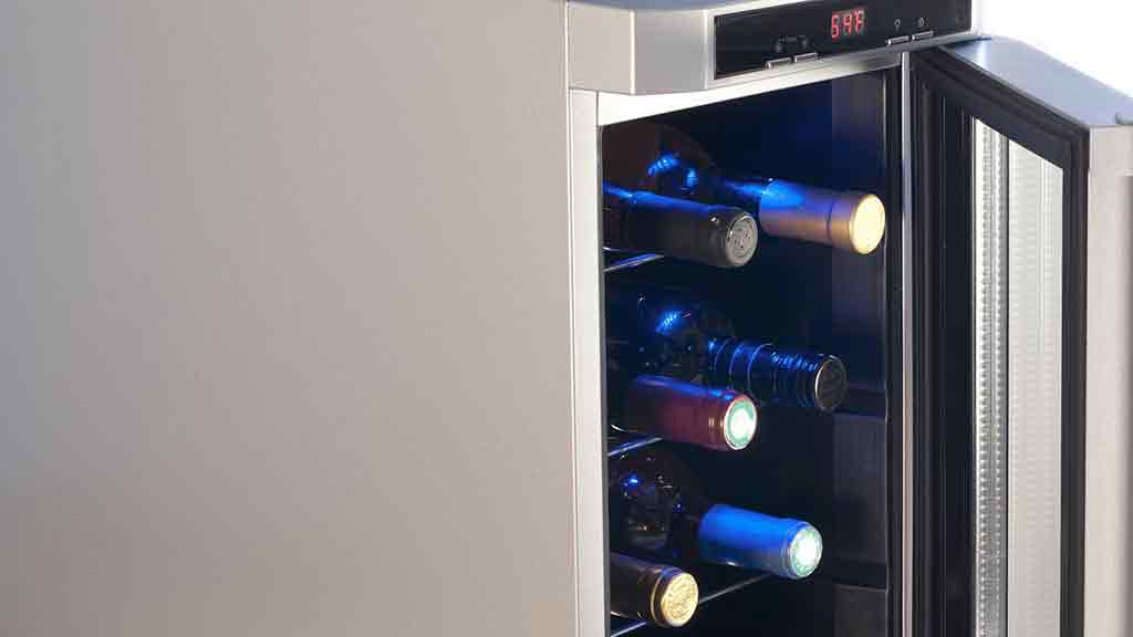 wine fridge open with bottles