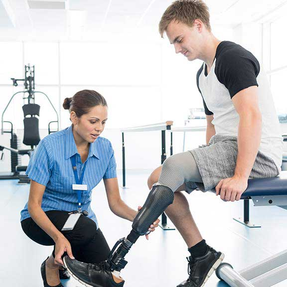 physio with patient prosthetic limb landing sq