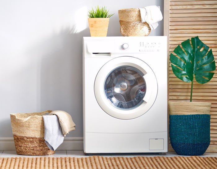 front loader washing machine in laundry