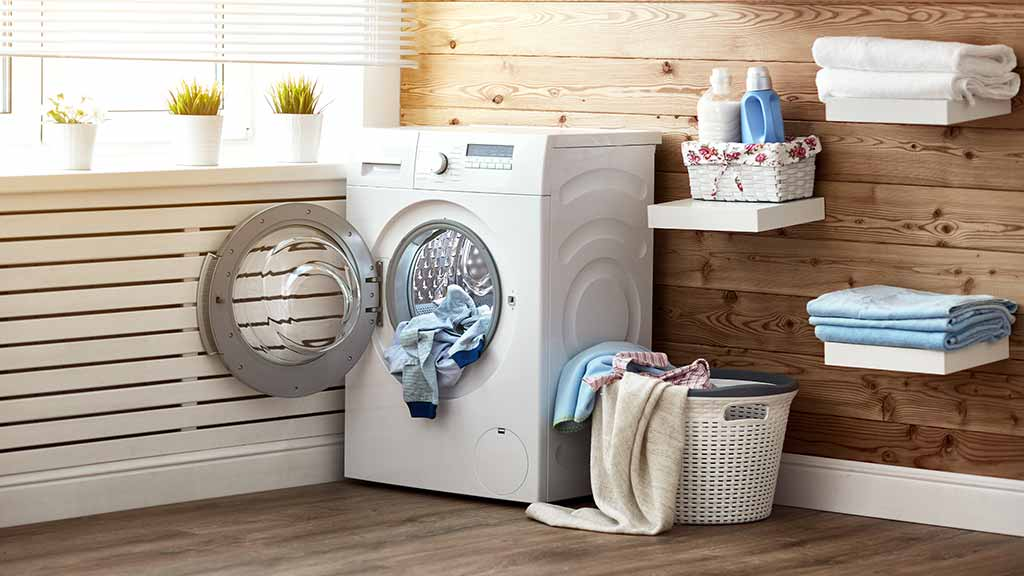 clothes dryer in laundry with dry clothes