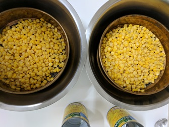 canned corn kernels draining in sieve